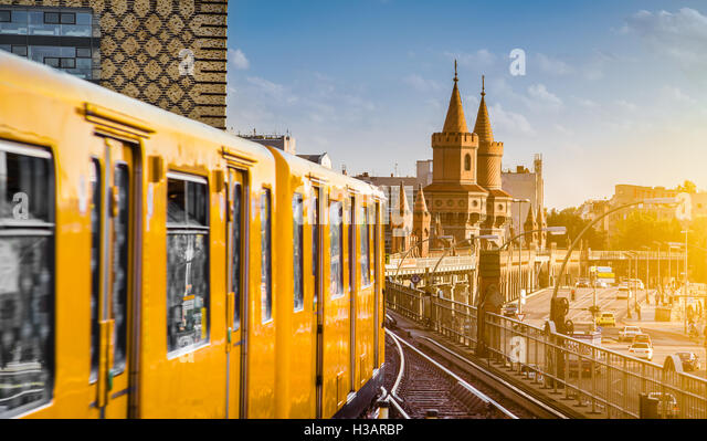 Panoramic view of historic Berliner U-Bahn with famous Oberbaum Bridge at sunset, Berlin Friedrichshain-Kreuzberg, - Stock Image
