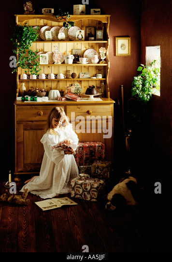 Victorian Christmas kitchen scene with child - Stock Image