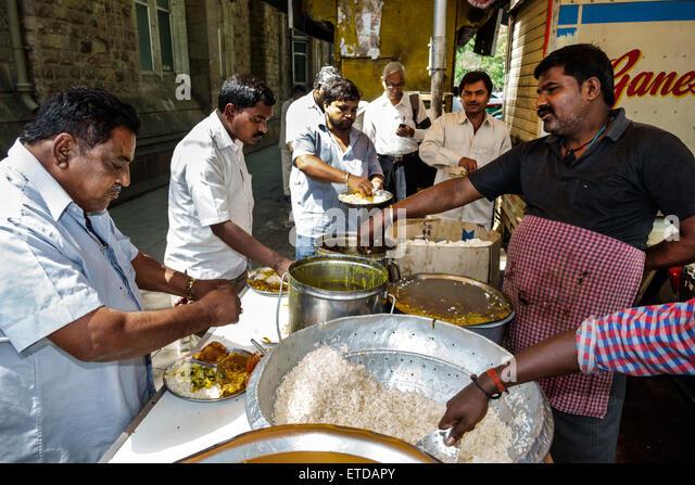 Mumbai India Indian Asian Fort Mumbai Kala Ghoda street food vendor man cooking eating - Stock Image
