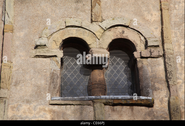 10th Century Double Anglo-Saxon window in the bell tower of St Peter's Church, Barton Upon Humber, Lincolnshire. - Stock-Bilder