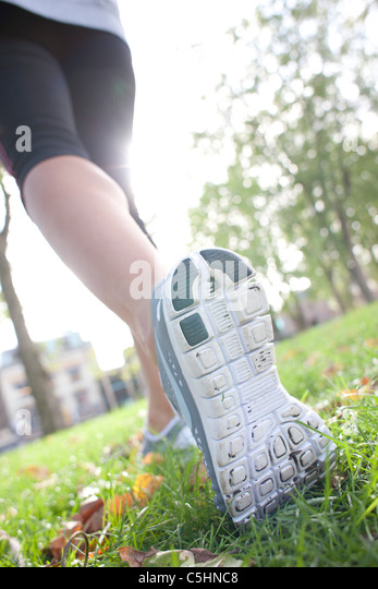 Woman jogging - Stock Image