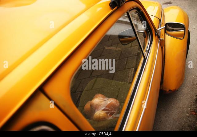 View through window of oranges on yellow vintage Volkswagen seat - Stock Image