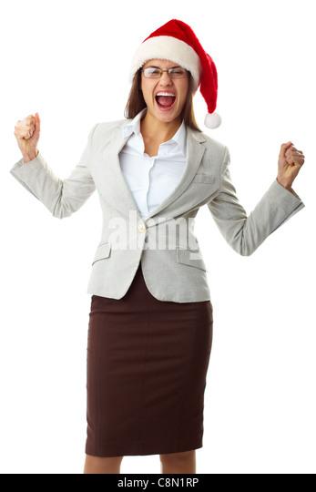 Portrait of ecstatic businesswoman in Santa cap shouting in triumph - Stock Image