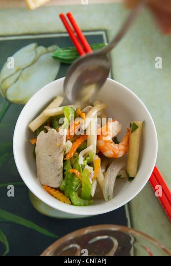 Lotus salad - Stock Image