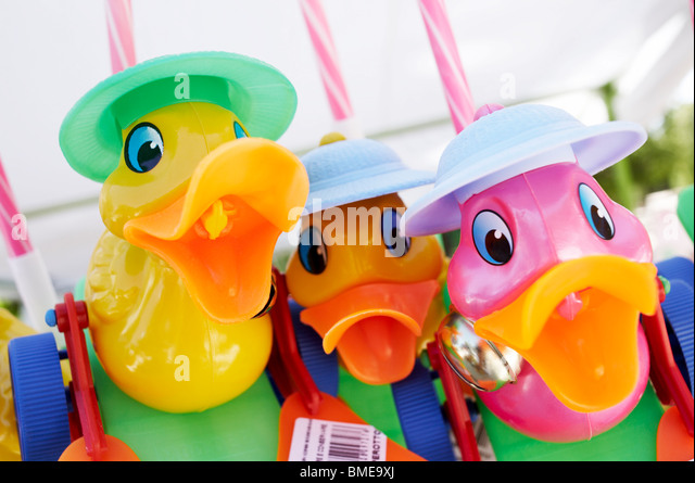 Three brightly colored toy ducks, Spain. - Stock Image
