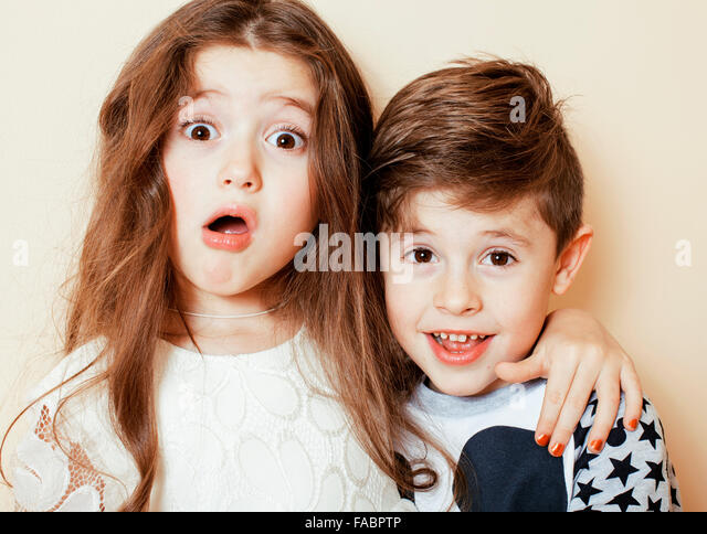 little cute boy and girl hugging playing on white background, happy family smiling - Stock-Bilder