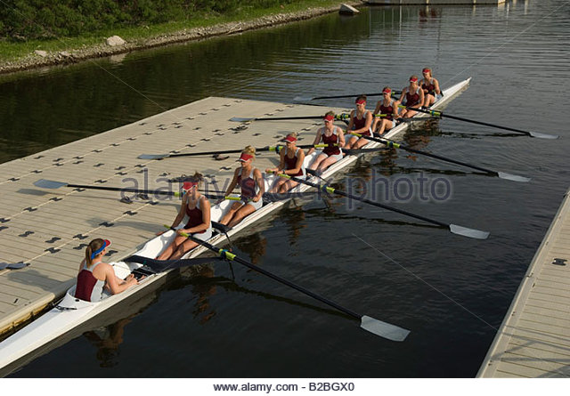Rowing team sitting in scull - Stock Image