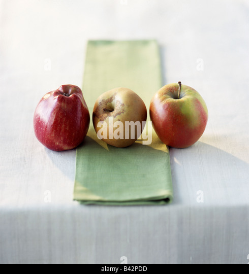 three apples: Red Delicious, Canada and Jonagold - Stock Image