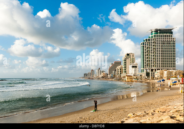 Tel Aviv skyline seen from the south - blue sky at golden hour - Stock Image