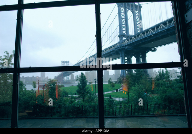 Urban Scene of The Manhattan Bridge in New York City USA Viewed Through a Window Copy Space - Stock Image
