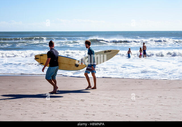 Cocoa Beach Florida Atlantic Ocean surf waves surfers family - Stock Image