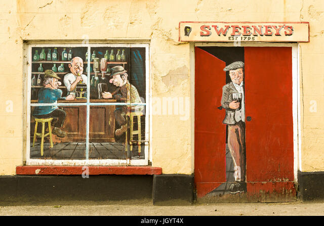 Sweeney's Bar old Pub wall art at Ramelton County Donegal Ireland - Stock Image