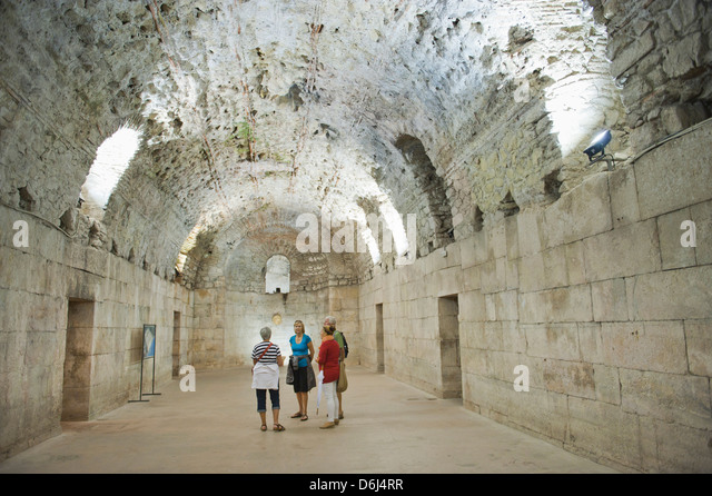 Tourists exploring the underground halls at Diocletian's Palace, UNESCO World Heritage Site, Split, Croatia, - Stock Image