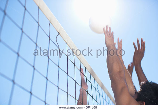 People playing volleyball - Stock Image