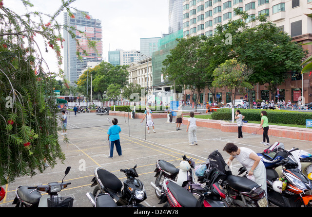 early morning badminton near Saigon River in downtown; Ho Chi Minh City; Vietnam - Stock Image