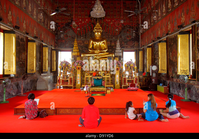 Thailand Bangkok Pom Prap Sattru Phai Wat Saket Ratcha Wora Maha Wihan Buddhist temple inside interior shrine Asian - Stock Image