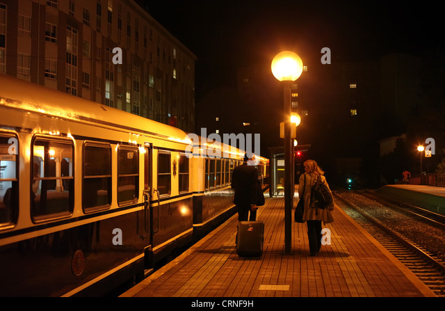 Passengers next to the Transcantabrico train, which travels across northern Spain. - Stock Image