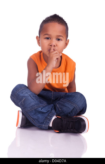 A portrait of a cute asian boy seated on the floor - Stock Image