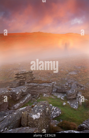 Brocken Spectre in mist at sunrise near Littaford Tor, Dartmoor, Devon, England. Autumn (October) 2011 - Stock Image