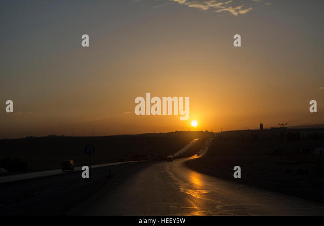 Sunset over a highway in Amman, Jordan. - Stock Image