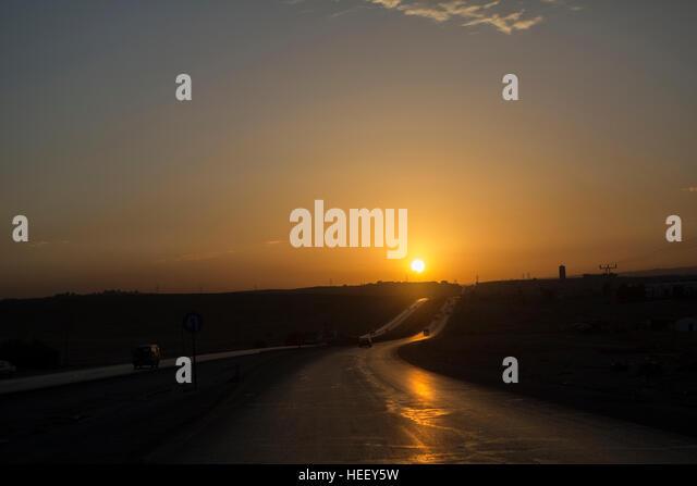 Sunset over a highway in Amman, Jordan. - Stock Image