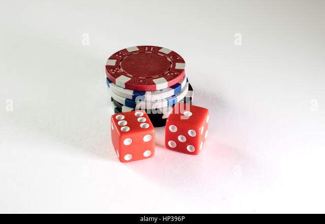 Gambling chips and dice on a white background - Stock Image