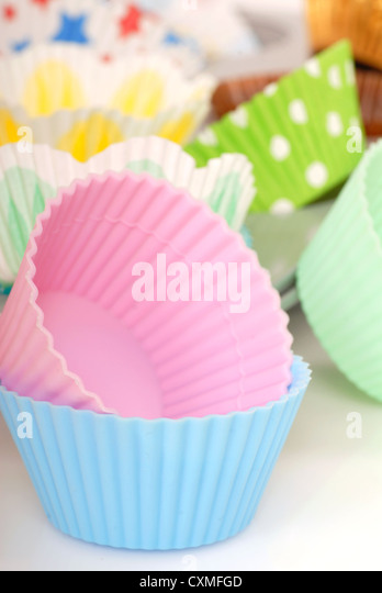 Variety of cupcake liners in different colors - Stock Image