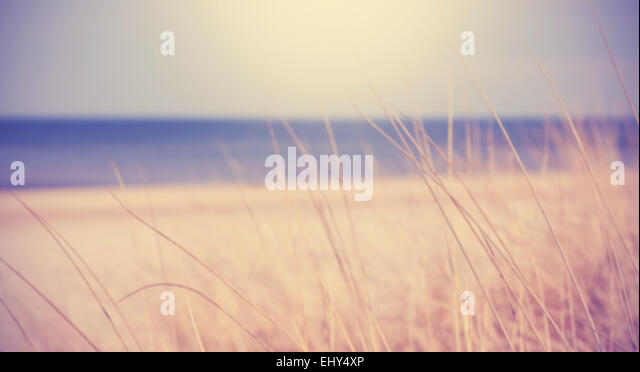 Blurred summer beach background in retro vintage style. - Stock Image