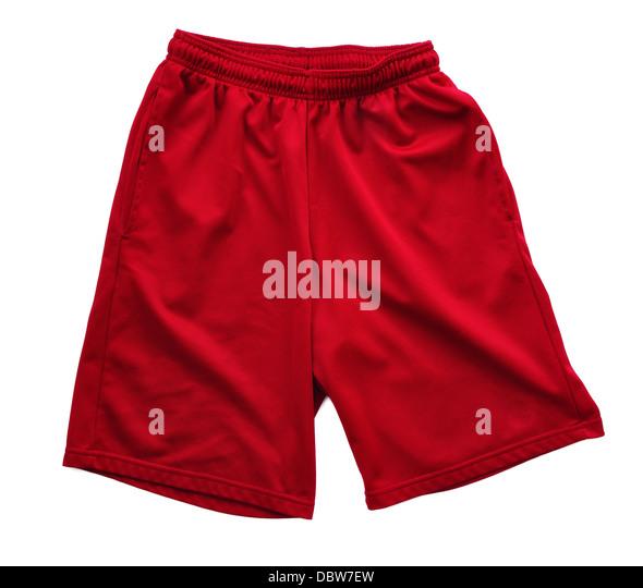 Red athletics shorts on a white background - Stock Image