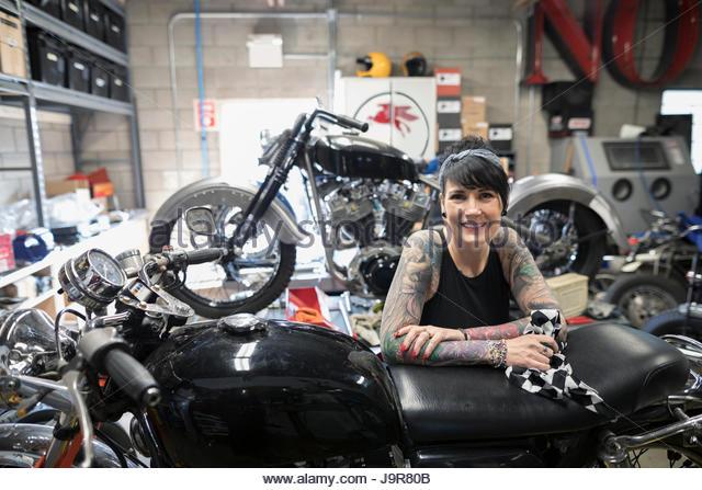 Portrait Confident Female Motorcycle Mechanic Stock Photos