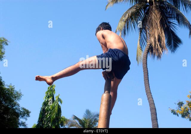 Malkhamb young boy performing gymnastics ; Thane ; Maharashtra ; India 2009 - Stock Image