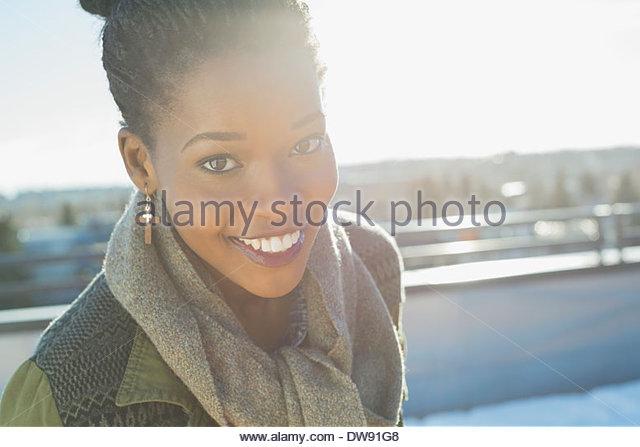 Portrait of smiling woman outdoors - Stock-Bilder