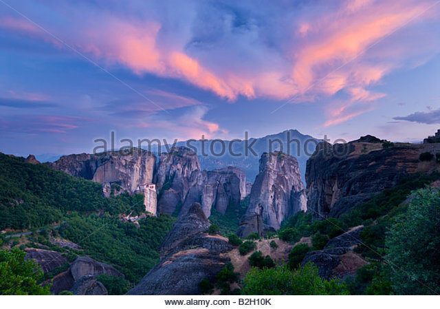 Sunset over The Holy monastery of Rousanou, Meteora, Greece. - Stock Image