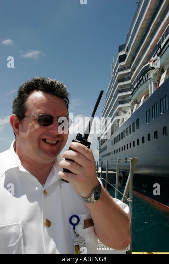 Grand Turk Cockburn Town Cruise Ship Center Holland America Line ms Noordam crew two way radio - Stock Image