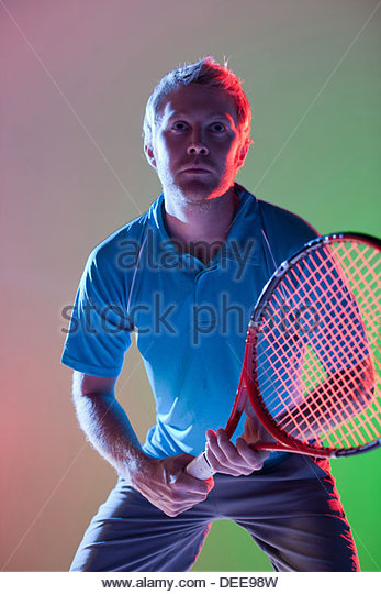 Tennis player holding racket - Stock Image