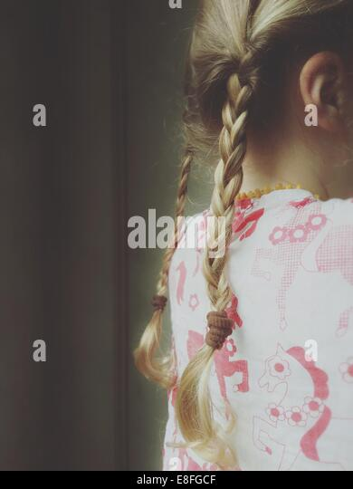 Close-up of a girl's plaits - Stock Image