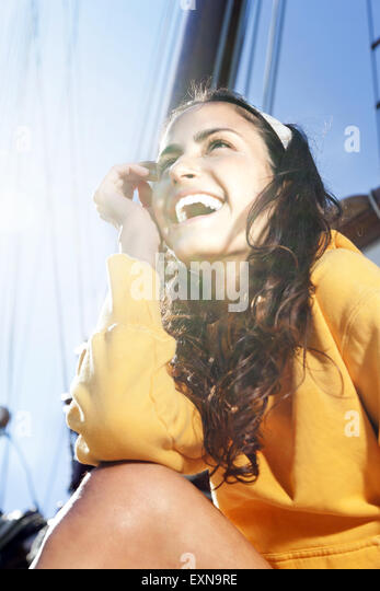 Happy young woman on a sailing ship - Stock-Bilder