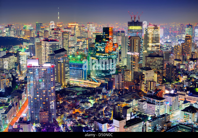 Dense buildings in Minato-ku, Tokyo Japan with Tokyo Sky tree visible on the horizon. - Stock Image