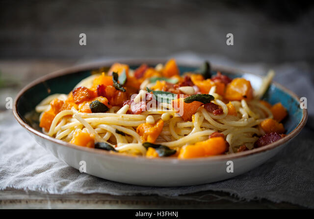 Spaghetti with roast butternut squash and sage - Stock Image