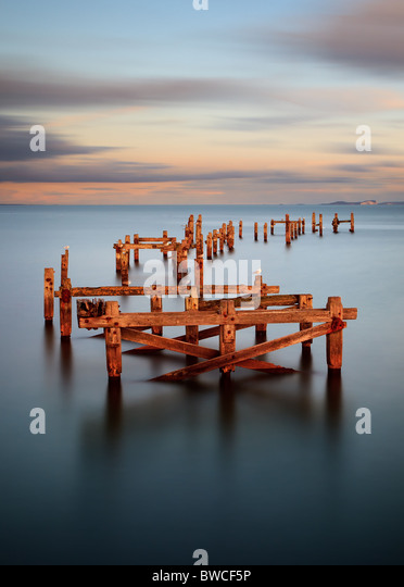 A long exposure image of the old pier in Swanage. Taken during an Autumn sunset. - Stock Image