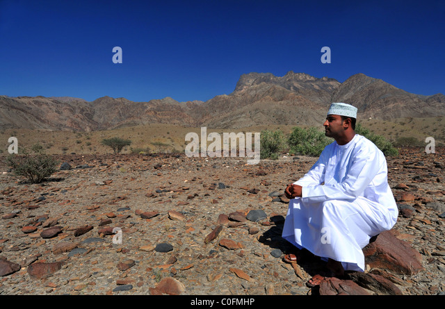 Wadi Bani Kharus, Oman with Omani man. The  Sultanate of Oman. - Stock Image