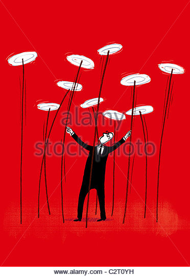 Businessman spinning plates on sticks - Stock-Bilder