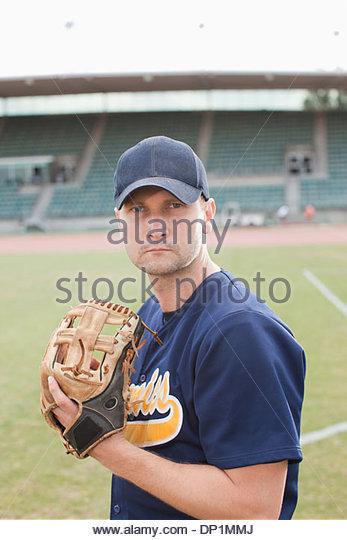 Baseball pitcher preparing to throw ball - Stock Image