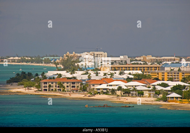 aerial George Town Grand Cayman condos beach green water scenic landscape shoreline - Stock Image