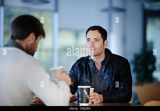 Men having coffee in cafe - Stock Image
