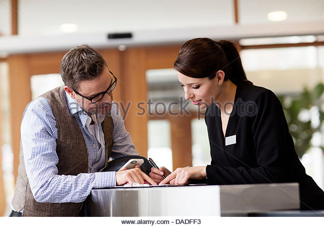 Man and woman looking down - Stock Image
