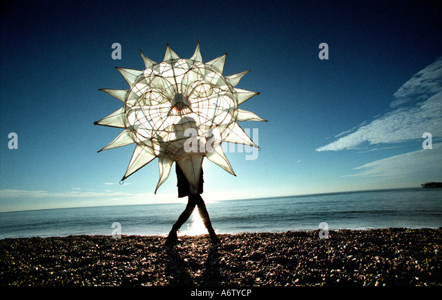 Winter Solstice celebration on Brighton beach at the annual Burning of the Clocks ceremony - Stock Image