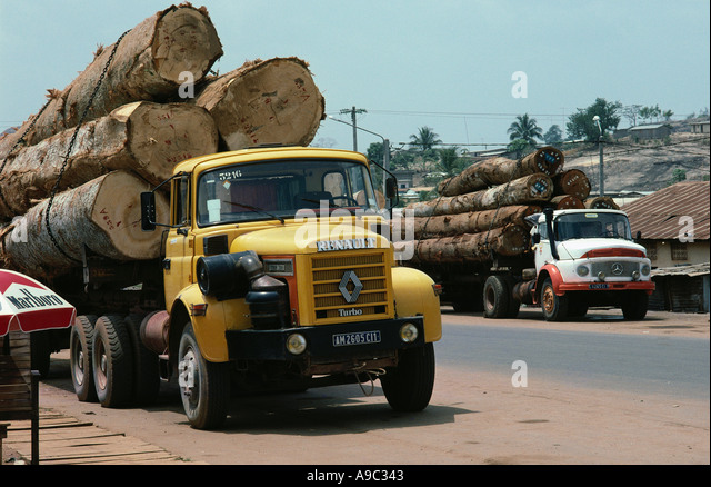 Deforestation Trucks loaded with logs in western Ivory Coast West Africa - Stock Image