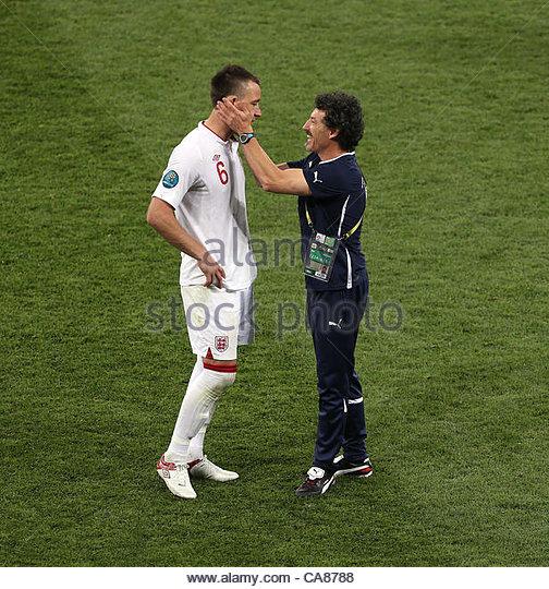 24/06/2012 Kiev. Euro 2012 Football. England v Italy. John Terry is consoled by a member of the Italian staff. Photo: - Stock-Bilder