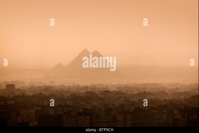 Cairo city skyline and Pyramids - Stock Image